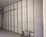 Dry wall partitions with lightweight aerated concrete infill