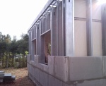 Cold formed steel structure building with lightweight cellular concrete infill